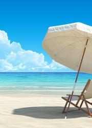 Beach chair and umbrella on idyllic tropical sand beach